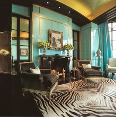 Glamorous turquoise and zebra combo in this OTT living space. Yes, if someone said I would dig laquered turqouise walls I would've called em crazy, but.....I like it.