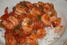 Shrimp Creole - Fresh shrimp, cooked in a spicy Creole tomato sauce and served over a bed of hot steaming rice.