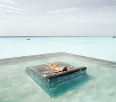 Or in the Maldives, your beach chair doubles as your bed, allowing you to sleep under the stars (girl not included).