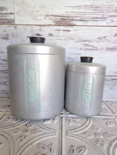 Vintage Metal Sugar & Tea Canister Set Hand by sorrythankyou79..My mom had these when first married in 1940...