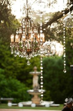 love this outdoor chandelier - is this something we could hire for decoration? Outdoor Chandelier, Chandelier Lighting, Outdoor Lighting, Crystal Chandeliers, Antique Chandelier, Lighting Ideas, Outdoor Decor, Party Mottos, White Gardens