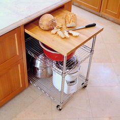 - Roll-Out Storage Cart This hidden yet accessible cart rolls out easily and serves as a cutting board and appliance storage cart. Keep Small Appliances Out of Sight - Storage Cart - Ideas of Storage Cart Small Kitchen Appliances, Kitchen Shelves, Kitchen Pantry, Kitchen Cart, New Kitchen, Kitchen Storage, Kitchen Decor, Kitchen Island, Kitchen Small