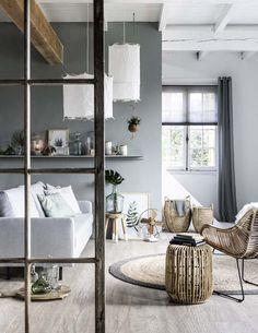 KARWEI | In deze kamer is er een mooie balans tussen grijstinten en natuurlijke materialen.