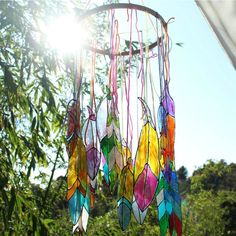 Get your boho decor on for the summer with this fun faux stained glass feather project! This tutorial uses gloss enamel paints to create unique home decor. Mark Montano featured on Kenarry.com