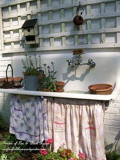 DIY:: Garden Repurpose ~ Potting Sink / Fountain from an old cast iron sink.  I wish I had kept the one that was in our basement when we moved in!