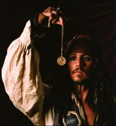 Captain Jack Sparrow and a piece of Aztec Gold ~ Pirates of the Caribbean: The Curse of the Black Pearl