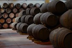 Cockburn's Port Lodge, Vila Nova de Gaia, Portugal — by Discover Near and Far. Take a tour of their wine cave and sample some delicious port wine afterwards.