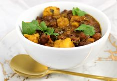 Black chickpeas simmered in a simple but rich and robust tomato, tamarind, mustard and spice sauce. A twist on chana masala.