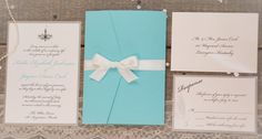 Buggy and Bentley - The Tiffany  Tiffany Blue Wedding Invitation with Silver Shimmer Accents, Swarovski Crystals and Feathers. Perfect for Tiffany themed weddings