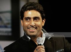 Indian actor Abhishek Bachchan (L), son of India's favourite film star Amitabh, smiles after he was announced the brand ambassador 'Motostar' for Motorola in Mumbai, late 03 June 2006. Bachchan, as the iconic 'Motostar', now joins tennis top seed Russian Maria Sharapova who is brand ambassador for Motorola globally. AFP PHOTO/Sebastian D