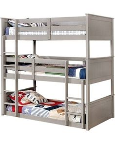 Our Templeton Gray Twin Size Triple Bunk Bed is a fun and trendy way to sleep 3 people in one room. This bunk bed blends style and function with plank-style beds ends and built-in ladders. It is perfect for siblings sharing a room, a guest room, or a vacation home. Includes: all 3 twin size beds, 4 guardrails, 2 straight ladders, and Euro-slats. It is built of wood solids and veneers in a sleek gray finish. At a later date, this triple decker bunk bed will separate into a low twin over twin…