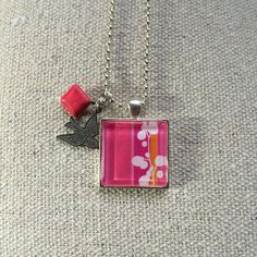 Pink Graphic with Bird Charm  Glass Pendant by What The Buckle
