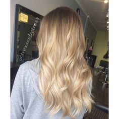 Soft blonde balayge ombre with golden and platinum tones