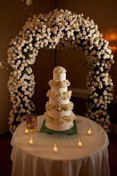 Got roses? A rose arch sets off this rose themed wedding cake