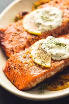 Easy, healthy baked salmon with creamy lemon dill sauce is a tasty 30 minute meal with simple ingredients and incredible flavor. These days I'm eating salmon weekly at the very least. I've always be