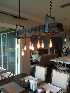 50 Awesome Industrial Farmhouse Design Ideas to Complement Your Home In If you are looking for [keyword], You come to the right place. Below are the 50 Awesome Industrial Farmhouse Design Ideas . House Design, House, Industrial House, Wood Light, Edison Chandelier, Industrial Farmhouse Lighting, Farmhouse Design, Wood Light Fixture, Edison Lighting