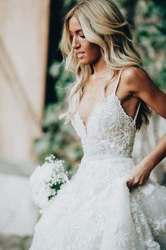 gorgeous lace and tulle wedding gown with a beautiful blonde hairstyle