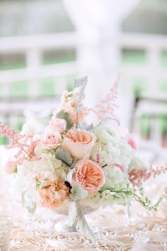 Peach centerpiece with sparkly table number | Photography: Hunter Ryan Photo - hunterryanphoto.com  Read More: http://www.stylemepretty.com/southeast-weddings/2014/04/28/romantic-southern-affair-in-fort-myers/
