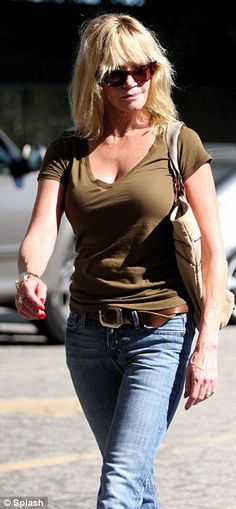 Melanie Griffith looking super cute in jeans and a tee
