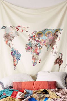 http://www.urbanoutfitters.com/urban/catalog/productdetail.jsp?id=34875849&parentid=BRANDS#/  Better than a headboard, this world map tapestry is inviting you to dream adventurous and keeps your decor flexible..