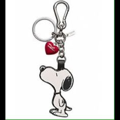 """NWT Coach X snoopy key fob/bag charm The Coach X Peanuts Snoopy & Woodstock Bag Charm, Limited Edition, is a perfect accent for your favorite bag! Snoopy hugging Woodstock makes this adorable gift for someone you love!   Item Description:  NWT Coach X Peanuts Snoopy & Woodstock Key Ring Fob Purse Charm.   Silver Tone Hardware.  Mini Coach Hangtag.  Dimensions: Approx. 1.75"""" (L) x 2.75 (H); Key Ring 1.25"""". Coach Accessories Key & Card Holders"""