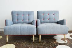 A fantastic pair of angular mid-century armchairs we sourced through our Chairloom Annex. They've been purchased by a client who chose Maxwell Fabrics's Homeboy textile in Denim with Lipstick contrast cording and buttons.