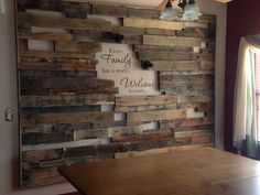 """Our newest project. A rough pallet frame wall that says """"Every Family has a story...Welcome to ours...""""  We will put up random pictures of all our adventures (as soon as I can find/make some antique/rustic picture frames).  The whole thing is back lit and looks awesome at night.  The lighted picture didn't do it justice."""