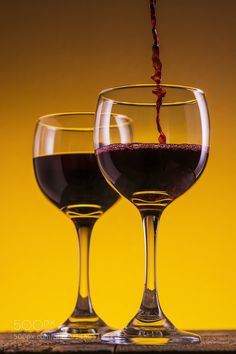 Pic: Red Wine pouring into wine glass with splash