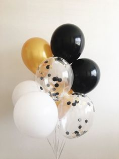 Welcome to Oh How Charming!  This listing is for (2) black (2) white (2) metallic gold and (2) clear black, white and gold mylar confetti 11 latex balloons. ~ Balloons ship flat & deflated ~ Clear Balloons are pre-stuffed with 1 circle black and white tissue confetti (gold is mylar shreds) ~ Can be filled with air or helium ~ Filling balloons with air will not float ~ Balloon shown in photo is filled with helium ~ To fill with helium use a personal helium tank or fill at your local party ...