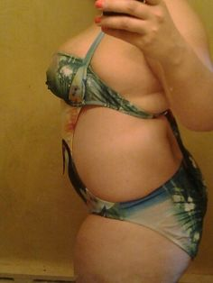 Side picture. Super cute bathing suit. But if you got big boobs like me lol. You might have to adjust yourself ALOT lol. But its so worth it :) :) :)
