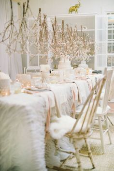 All-White Everything: Hey, you're eventually gonna be donning a white dress, yeah? Hint at the main event with an all-white party. We love that this styled soiree includes hanging flowers from above.