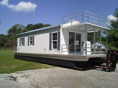 Catamaran Cruiser Trailerable Houseboats for sale factory direct. Aqua Lodges are great rental income for marinas alternative to waterfront rental property. Pontoon Houseboat, Houseboat Living, Trailerable Houseboats, Water House, Boat House, Wooden Boat Plans, Floating House, Tiny House Movement, Sustainable Architecture