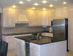 Image from http://icanhasgif.com/wp-content/uploads/2014/10/Painting-White-Oak-Kitchen-Cabinets.jpg.
