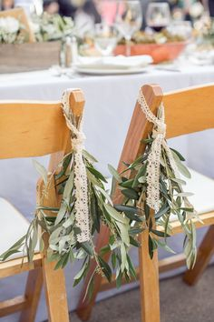 Chair Decor | Simple, Elegant | See the wedding on #SMP Weddings: http://www.stylemepretty.com/little-black-book-blog/2013/12/26/holman-ranch-wedding/  Photography: Carlie Statsky Photography