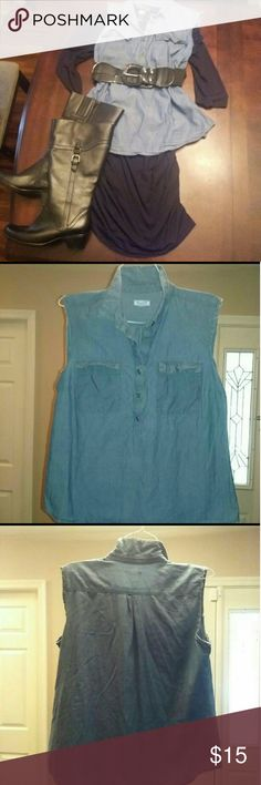 Distressed old navy sleeveless shirt Cute denim shirt with shirt tail hem. Pullover style. Buttons go from neck to midsection Has been altered to make distressed sleeveless top.  Can be dressed up with a skirt and dressed down with jeans.  Tags: sleeveless, lightweight, cool, blue, denim, Jean collar, button down, pullover, tank top, cutout, altered,  summer Old Navy Tops