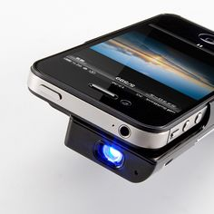 Micro Projector For iPhone.  Watch movies on your wall or project your pictures.cooool