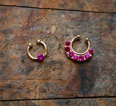 Super cool tiny gold tribal faux septum ring set with faux opal rhinestones. Two pieces! Great way to have a fake nose piercing without the pain! Cute for festivals this summer!