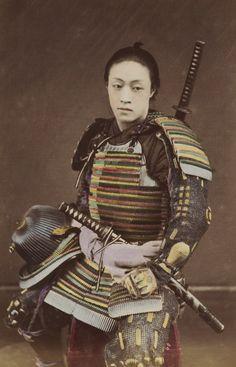 Hand-colored photo-portrait of a man in samurai armor. Circa 1876, Japan. Photographer Kozaburo Tamamura