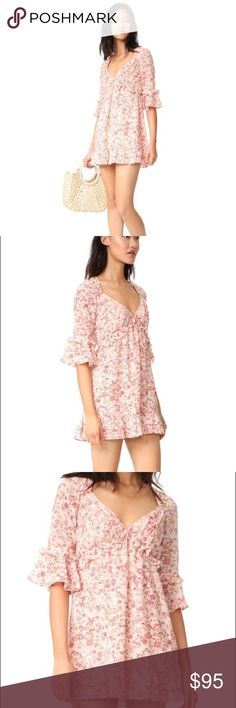 NWT For Love and Lemons Mini Churro Dress Mini Churro Dress in 'Summer Floral'. Brand new with tags never worn. Size XS. For Love And Lemons Dresses Mini