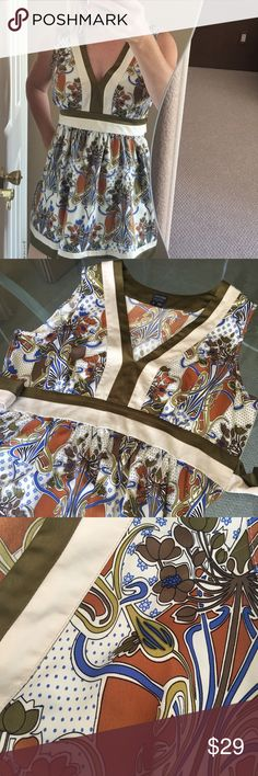 Nicole by Nicole Miller Satin Floral Patterned Top Super cute and comfortable Nicole by Nicole Miller sleeveless satin top. Floral patterned, ties in back, v-neck. Great top in perfect condition! ❤️ Nicole by Nicole Miller Tops