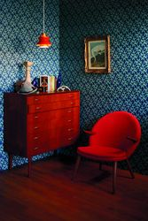 The red chair, the light fixture . . .