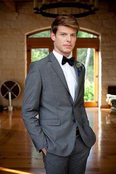 groom in a grey suit // photo by She-N-He Photography // http://ruffledblog.com/texan-garden-wedding-ideas