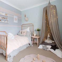 Love this pretty little girl's room! String Pocket Shelf available online.