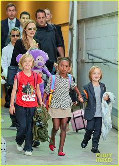 Angelina Jolie Arrives in Sydney with All Six Kids!: Photo Angelina Jolie flashes a big smile as she touches down at Sydney Airport with all six of her children - Maddox, Pax, Zahara, Shiloh, and five-year-old…