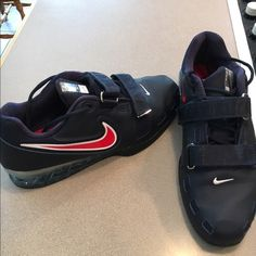 Nike weight lifting shoes Nike Romaleos 2 weight lifting shoes, size 10, navy with red swoosh. Never been worn, perfect condition. Nike Shoes Sneakers