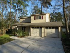 Street view: 2105 N Red Cedar Circle, The Woodlands, TX., 77380.