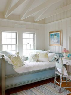 Cottage, Country and Coastal - here a Swedish daybed is tucked into a nook and surrounded by a room full of windows. This is a great summer cottage look - Mix and Chic