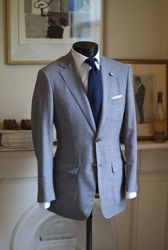 men's grey suit- blue tie