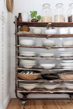 Looks a little wobbly but I like the idea. Maybe if you could strengthen the shelves. Looks a little wobbly but I like the idea. Maybe if you could strengthen the shelves. Kitchen Storage, Kitchen Decor, Kitchen Design, Plate Storage, Kitchen Cart, Kitchen Shelves, Mint Kitchen, Dish Storage, Storage Cart