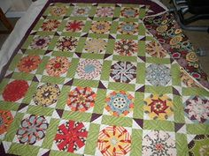kaleidoscope quilt made with freebird fabric.